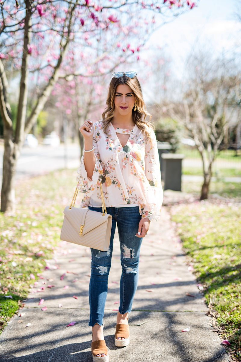 the first sign of spring, spring fashion, spring outfit inspo, spring outfit ideas, floral fashion, floral top, ysl envelope purse, distressed jeans, blush heels, karen walker sunglasses, sun and shadow top, pink blush top, floral shirt