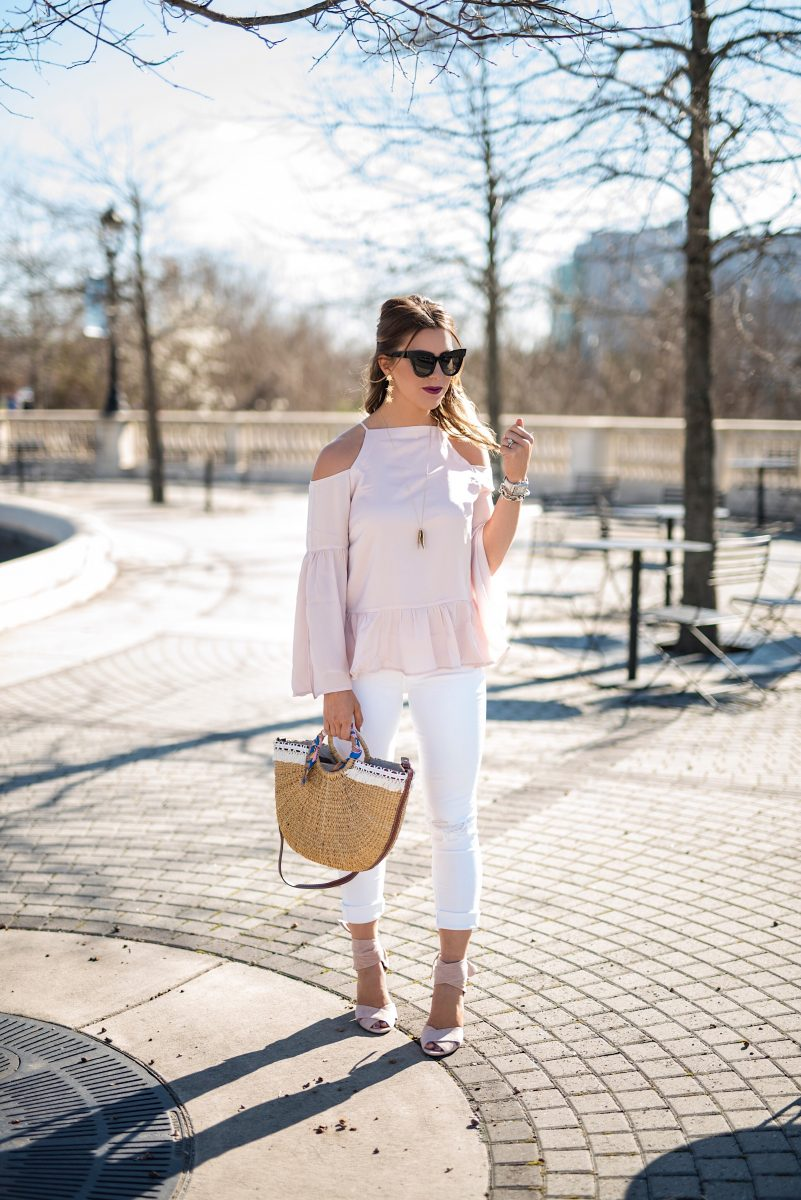 simple and sheer, simple and sheer top, blush top, bell sleeve blush top, distressed white jeans, beach purse, basket purse, pink heels, cat eye sunglasses, black sunglasses, spring outfits, spring inspo, spring outfit ideas, sam edelman basket purse, angel wing necklace, baublebar statement earrings