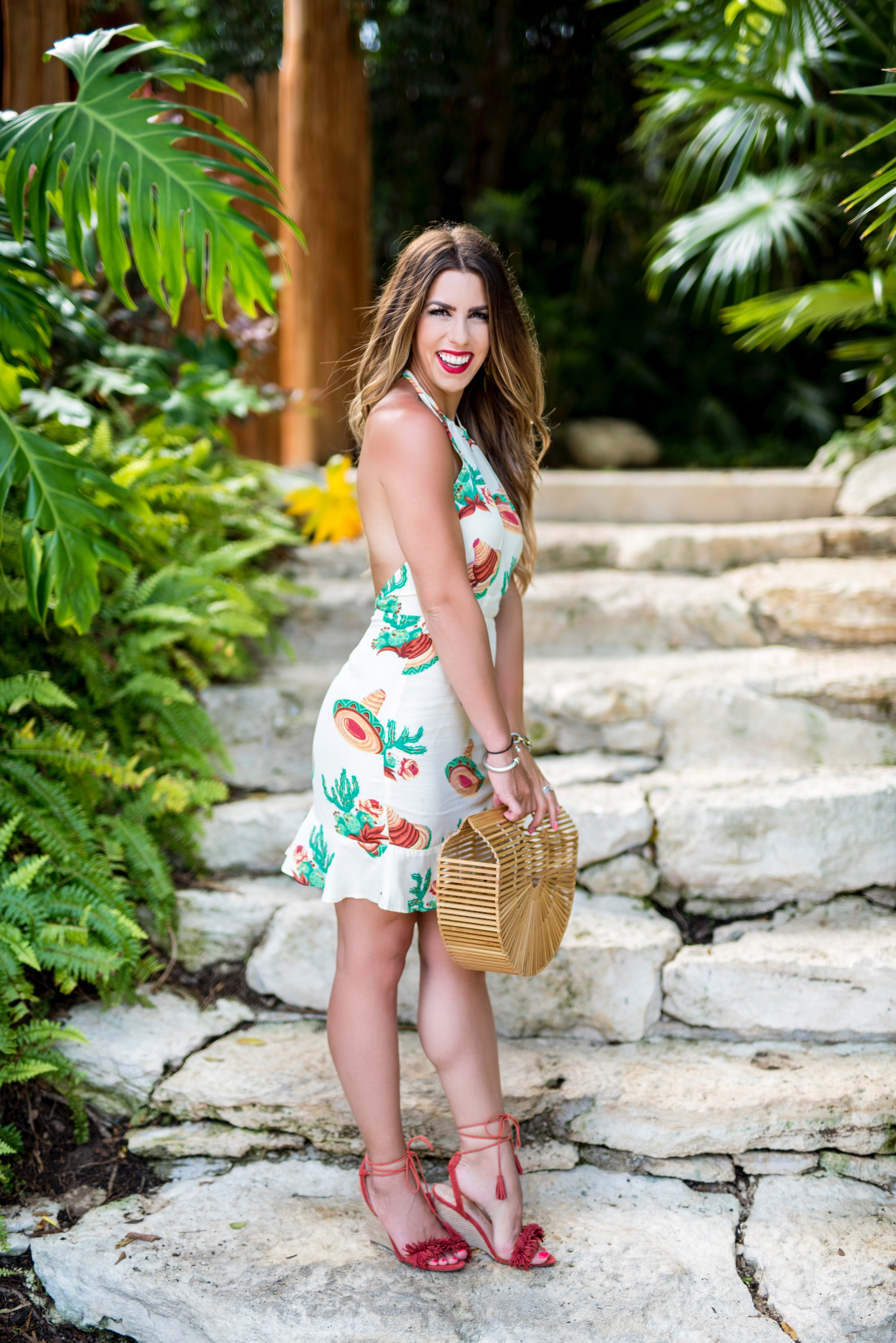 sombreros and cacti cactus dress cactus print the perfect dress to wear in mexico printed dress white dress in mexico cacti print cactus dress travel to mexico what to wear on vacation cult gaia purse vacation style vacation outfit inspo outfits for vacation travel to mexico
