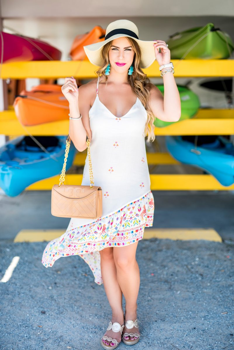 colorful canoes 5 things to do before summer ends white maxi dress white midi dress colorful maxi dress tassel earrings what to do before summer ends summer fashion summer style summer outfit inspo ocean isle beach here's the skinny travels @baileyschwartz #htstravel