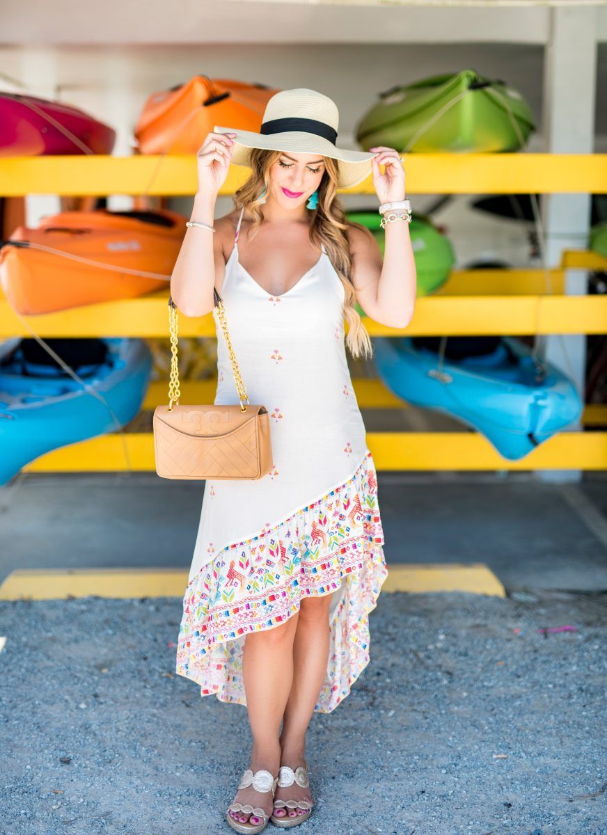 colorful canoes 5 things to do before summer ends white maxi dress white midi dress colorful maxi dress tassel earrings what to do before summer ends summer fashion summer style summer outfit inspo ocean isle beach here's the skinny travels @baileyschwartz #htstrave