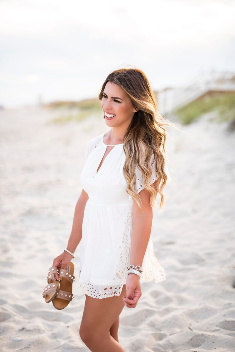 toes in the sand last day of summer white romper free people romper white dress on a beach summer fashion summer outfit inspo beach outfit what to wear for summer beach pictures fashion blogger inspiration