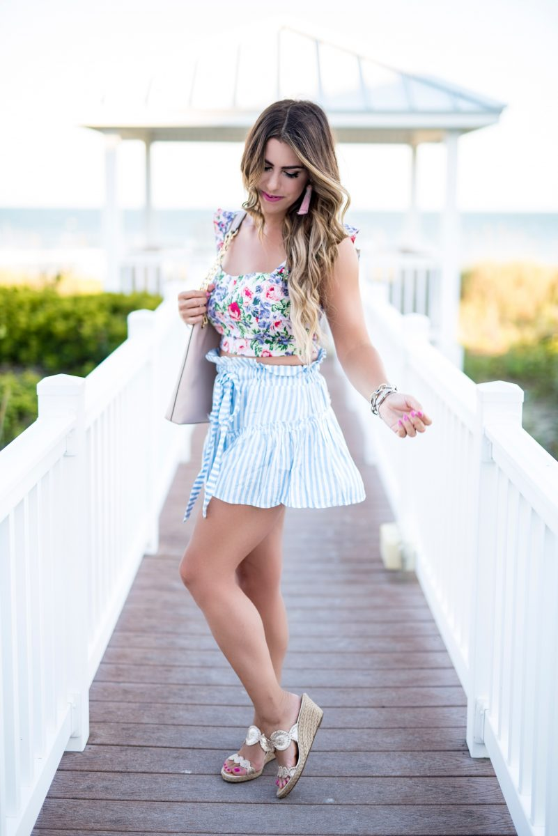 floral crop top blue stripes revolve crop top what to wear at the beach pattern play outfit outfit with pattern mixing striped shorts ocean isle beach outfits at the beach summer fashion summer outfit ideas summer outfit inspo