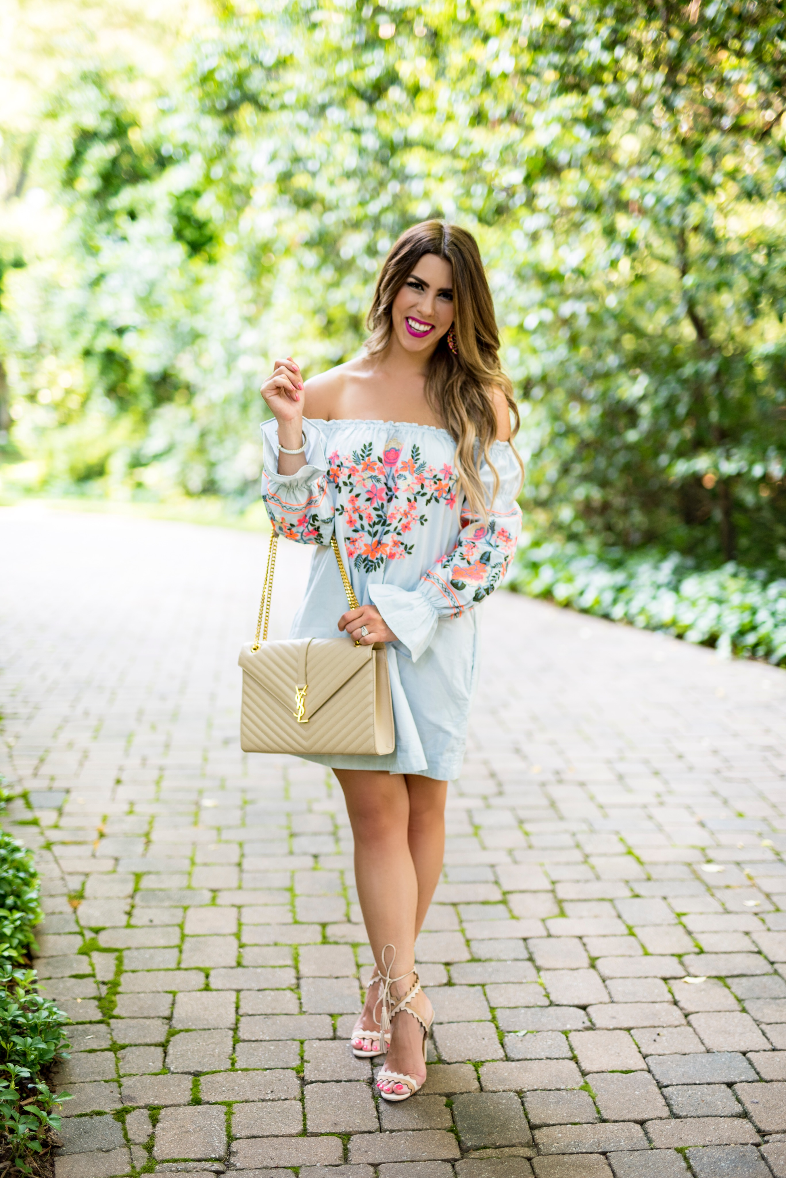 trend to try statement sleeves bell sleeves embroidered sleeve dress embroidered dress dresses with statement sleeves ysl purse free people dress my favorite summer dresses summer style summer fashion light blue dress with hot pink embroidery charlotte blogger