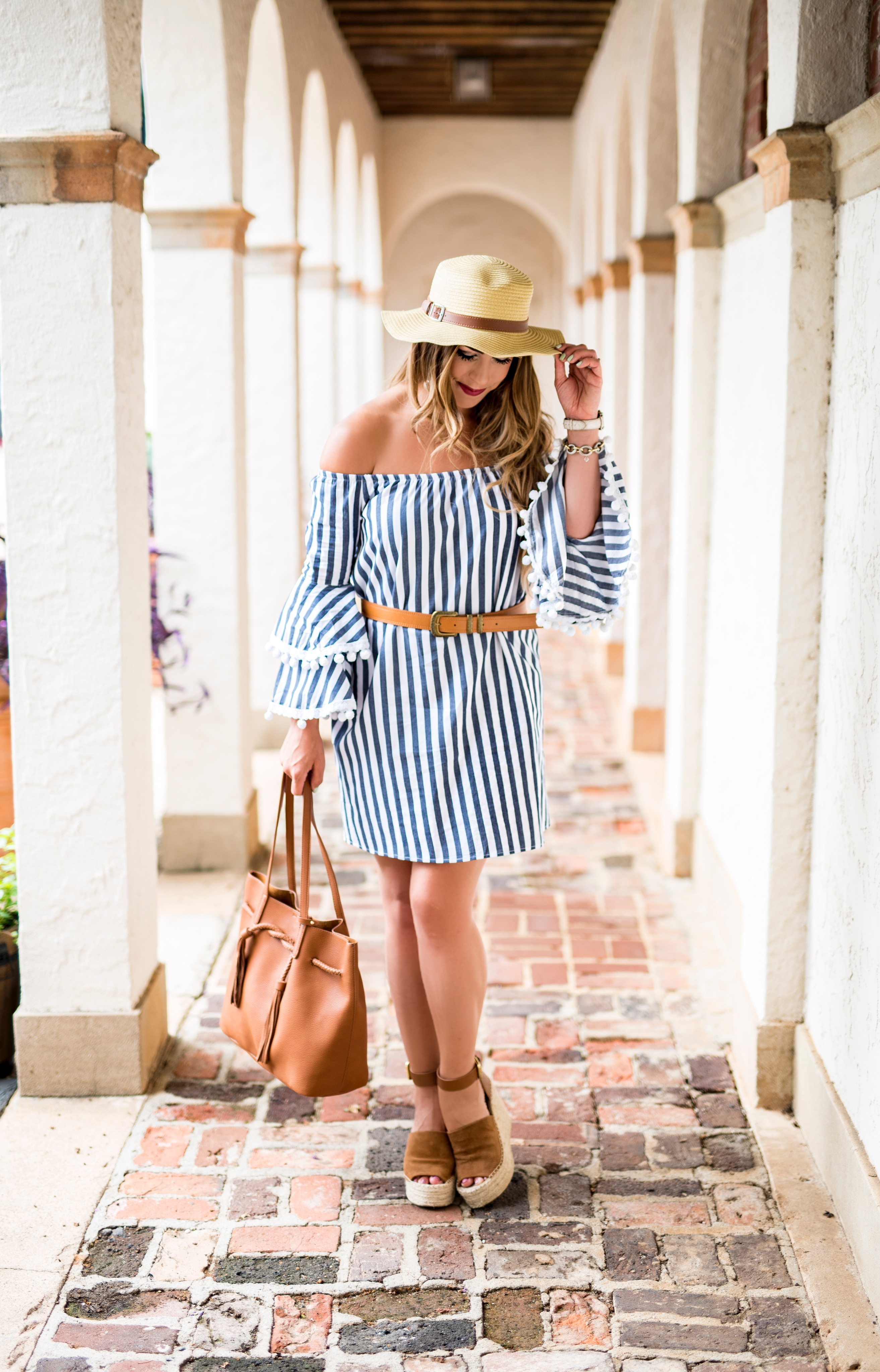 striped pom pom dress vaya by joy haan dress dresses at revolve striped dress boater hat camel accessories striped off the shoulder dress perfect travel dresses travel look travel fashion how to accessorize summer fashion summer outfit ideas summer outfit inspo
