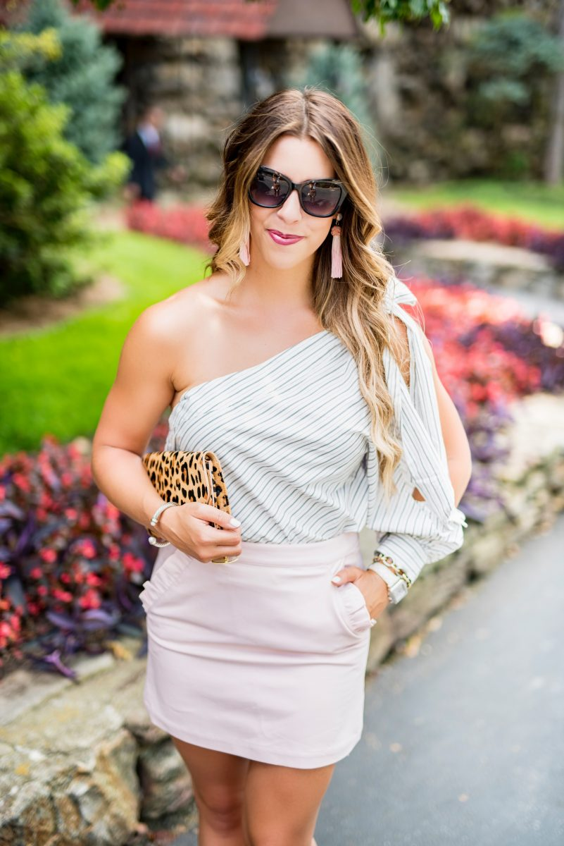wednesday workwear striped one shoulder shirt pink ruffle skirt express skirt pink mule slides fuschsia mules what to wear to work work wear inspiration workwear style