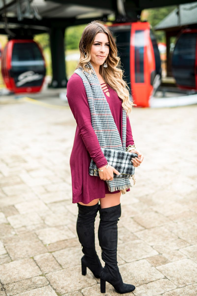 a chilly vermont day burgundy sweater dress houndstooth blanket scarf houndstooth scarf plaid scarf burgundy dress sweater dress stowe vermont what to wear on a fall getaway what to wear in vermont over the knee boots black boots black knee high boots