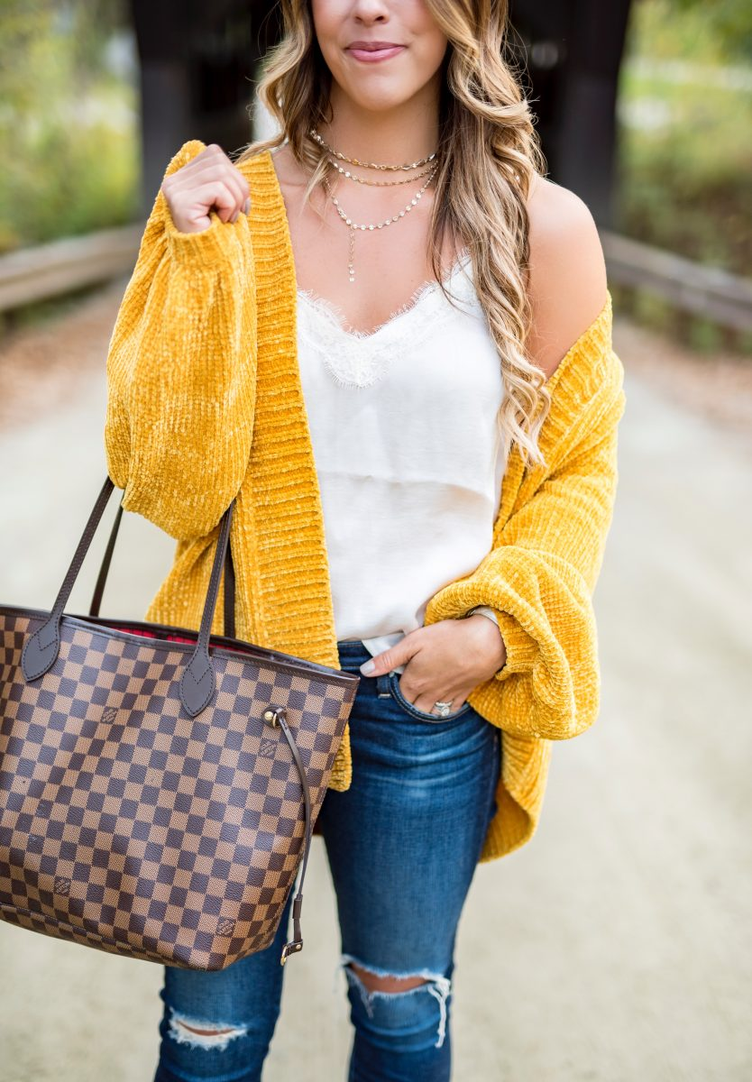 a covered bridge in vermont yellow chenile cardigan yellow cardigan mustard cardigan fall sweater fall cardigan ditressed jeans white camisole fashion blogger fall style brown booties louis vuitton neverful under a covered bridge in stowe vermont