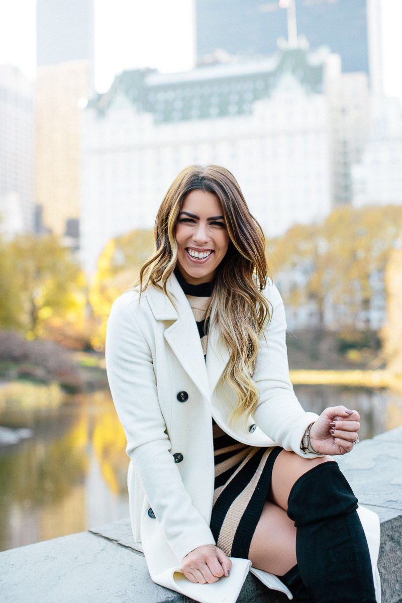 central park jcrew striped dress black and camel striped dress olivia pope jacket white peacoat black over the knee boots photos of central park winter fashion winter outfit ideas winter outfit inspo fashion blogger winter style gapstow bridge