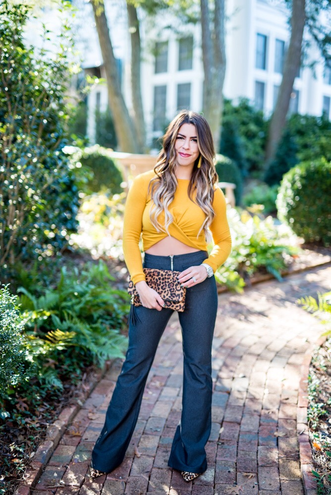 twisted crop top bell bottom pants vestique crop top vestique boutique mustard crop top yellow crop top flattering crop top leopard clutch best boutiques to shop at leopard accessories fall fashion fall outfit fall style