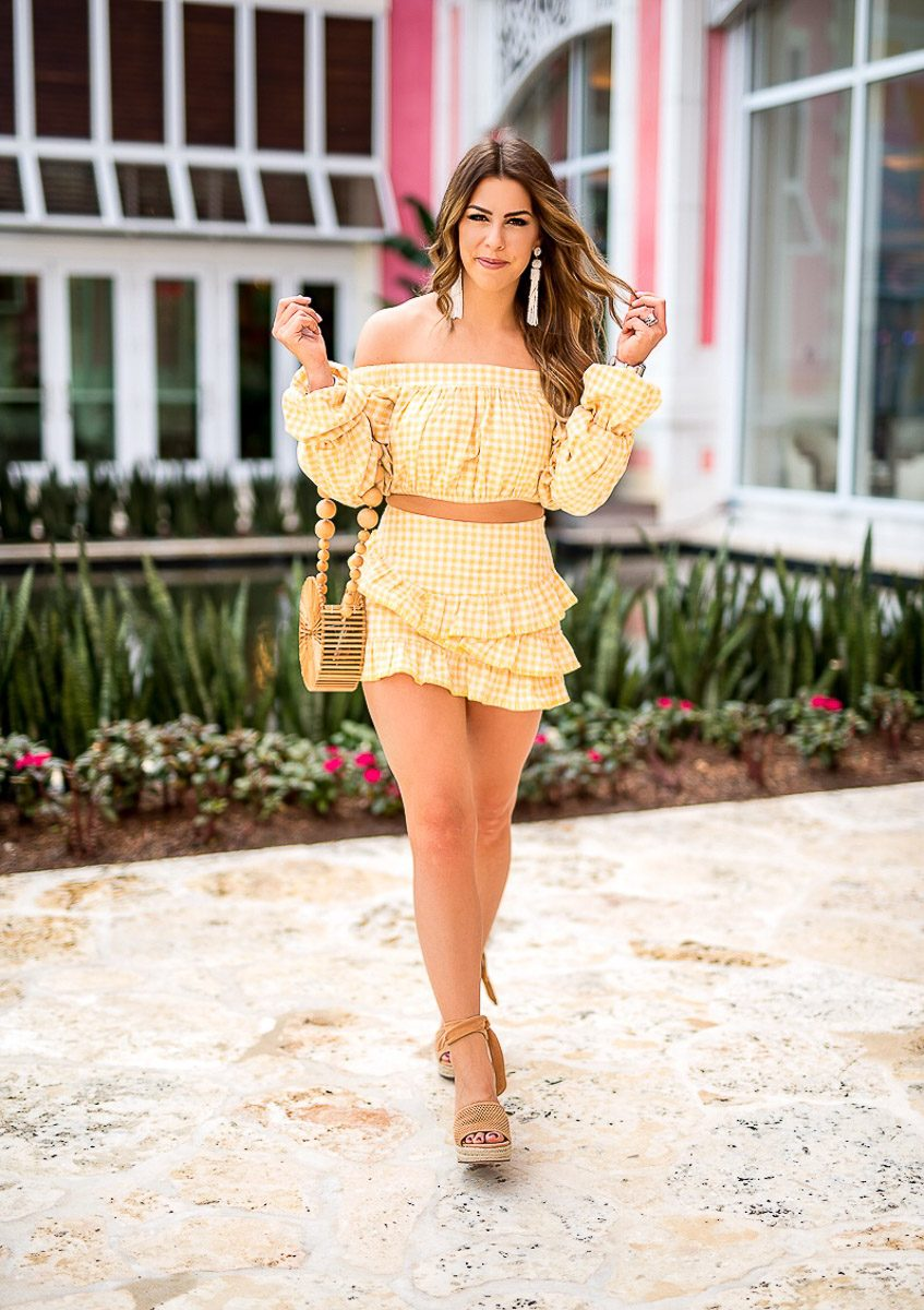 yellow gingham two piece set lovers and friends two piece set cult gaia purse spring outfit spring fashion spring outfit inspiration yellow off the shoulder top yellow skirt ruffled skirt brown wedges wedge sandals beach bag spring bag grand hyatt baha mar in the bahamas travel style