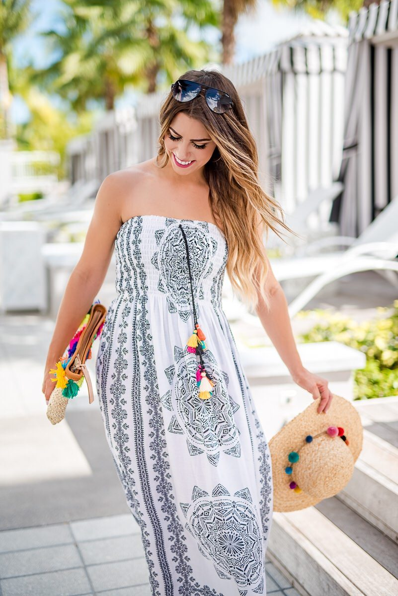 black and white swimsuit coverup the best swimsuit coverups for summer swimsuit coverups for vacation boho swimsuit coverups black and white maxi dress black and white summer dress pops of color with black and white dress pom pom beach hat pom pom clutch black and white tribal dress spring fashion spring outfit spring style