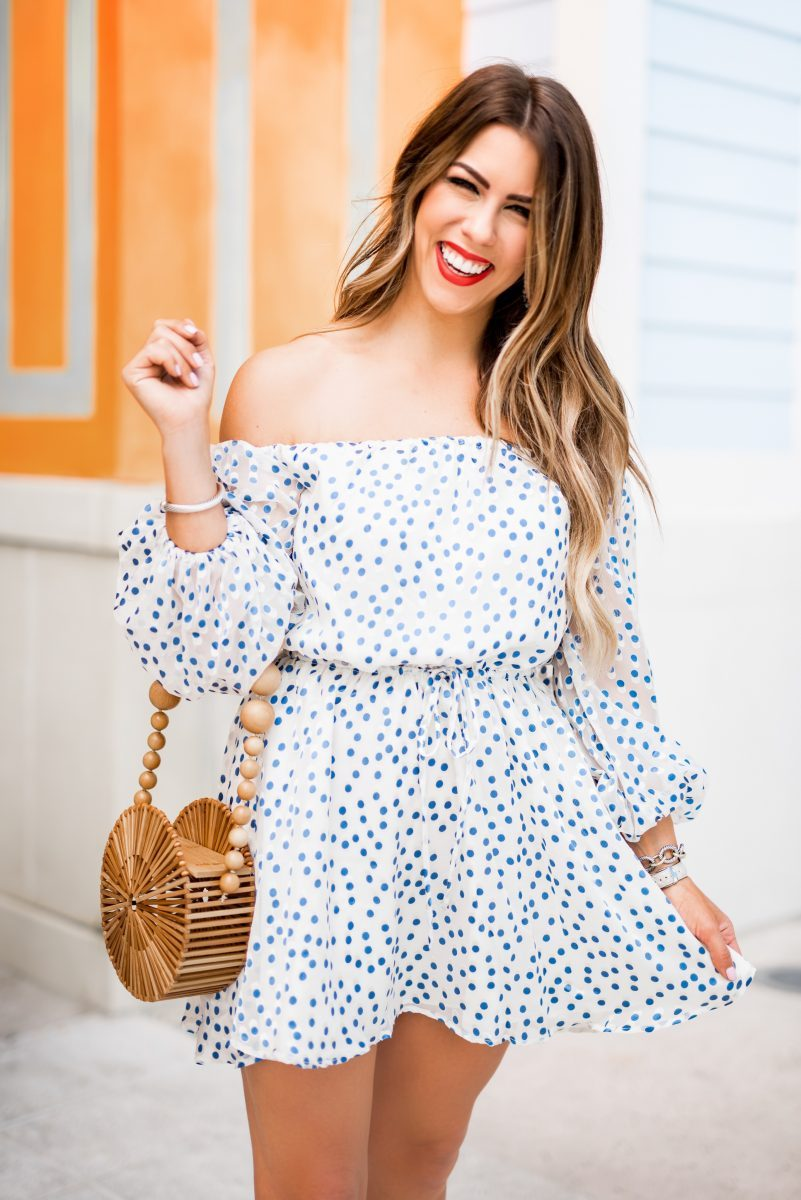 lovers and friends blue polka dot dress lovers and friends off the shoulder dress revolve off the shoulder dress spring dresses what to wear for spring spring style spring outfit inspiration spring dress blue polka dot dress cult gaia bag