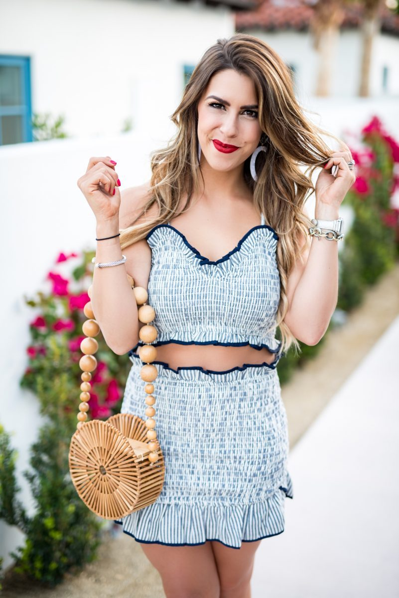 blue gingham set in palm springs lovers and friends two piece set gingham blue two piece set gingham skirt gingham crop top blue skirt blue crop top palm springs la serena villas in palm springs cult gaia bag spring fashion spring style spring outfit inspiration